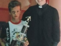Micheal Clancy, Under 12 Player of the Year 1992/93, pictured with Fr. Joe Cussen.