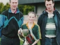 Managers Seamus Burke (left) and Eoin Barrett with captain Conor Lyons following Division 2 League success 1999/2000.