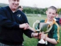 Under 12's captain Conor Lyons receives the  Division 2 trophy from Charlie Boyle