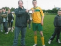 Captain John Walsh accepts the cup from League P.R.O. Pat Mulvihill.