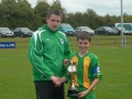Captain Mikey Hickey accepts cup from Tom Ambrose