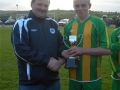 Ger Costello LDSL Registrar presents cup to Mikey Morrissey