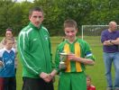 Alan Murphy receives U14 cup 2011/12 from Tom Ambrose
