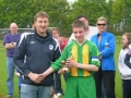 Man Of The Match Alan Murphy receives award from League Chairman Dave Naughton