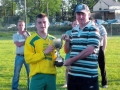 Captain Kevin Moynihan accepts the Under 16 Cup from LDSL P.R.O. Pat Mulvihill.