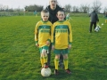 Mascots Edward Houlihan and Mark Storin with team manager Tom Burke