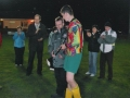 Captain John Ruttle receives the trophy from P.J. Hogan of the LDFL.