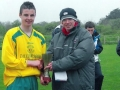 Anthony Forde receives his Man of the Match award from LDFL P.R.O. Frank Nelligan.