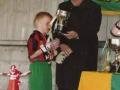 Ballingarry AFC club president Moss Doody presenting the winning captain with the Under 8 UEFA Cup trophy.