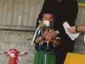 Ballingarry AFC club president Moss Doody presenting the winning captain with the Under 8 Champions League trophy.