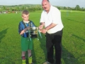 Captain of 'Inter Milan' Mikey Morrissey receives UEFA Cup from George Quinlivan.
