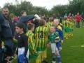 Teams shake hands at the finish