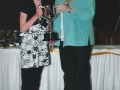 Girls under 10 captain Aine Lenihan receives  under 10 Divison 1 League Trophy from guest of honour Margaret Stokes.