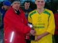Captain Sean Lenihan receives league trophy from LDFL PRO Frank Nelligan