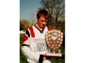 Francis Kiely, captain of the youth team, pictured with the Division 2 trophy.