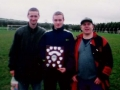 Ballingarry AFC Youth captain Colm Kiely pictured with team managers John Cronin (left) and James Clancy (right) and the Division 3 trophy for season 1999/2000.