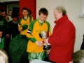 The victorious Ballingarry AFC Youth team captain Francis Kiely receives the cup from John Hogan of the Desmond District League. It was Ballingarry's first ever success in the competition.