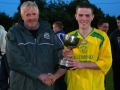 Ballingarry AFC captain Sean Lenihan accepts cup from Tim O'Connell