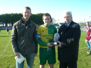 Colm Kiely 364 appearances for Ballingarry AFC. Receiving award from President Moss Doody also in picture is James Higgins whose record Colm broke.